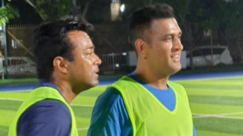 """Although MS Dhoni and Leander Paes were seen wearing practice jerseys with """"Playing for Humanity"""" written on them in the pictures, the cause of the charity and the date of the match is unclear. (Photo: Facebook/Rhiti Sports)"""