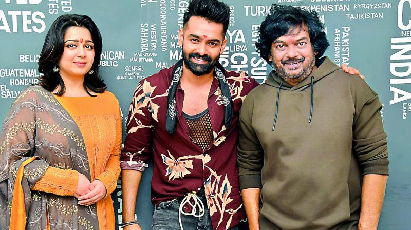 Charmee and Puri Jagannath with Ram at the launch.