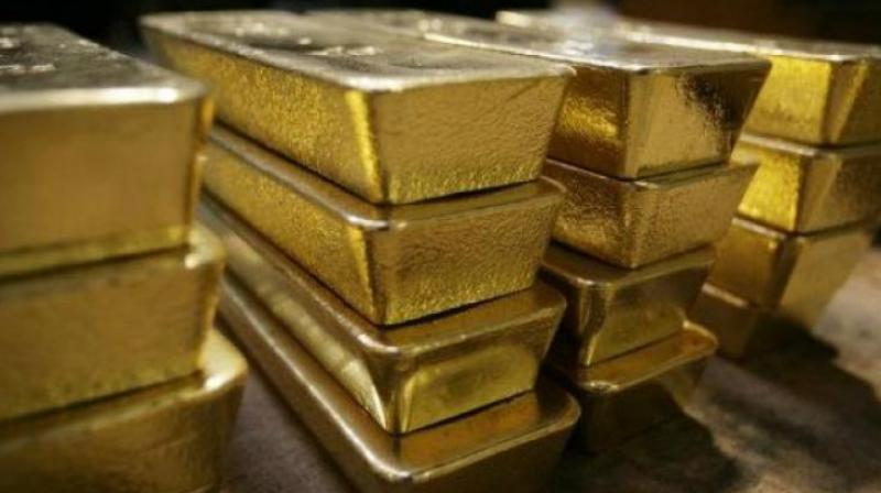 Globally, gold spot ended the week at USD 1,328.90 an ounce and silver at USD 16 an ounce in New York. (Representational Image)