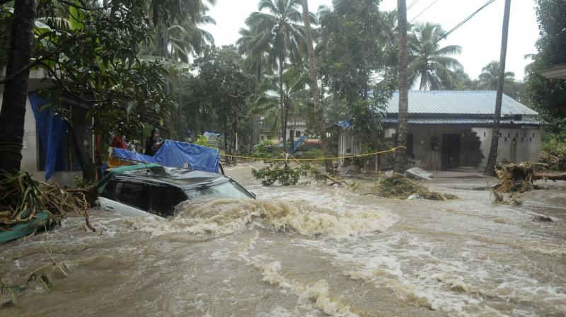 Landslides triggered by heavy monsoon rains killed more than a dozen people, cutting off road links and submerging several villages in Kerala. (Photo: AP)