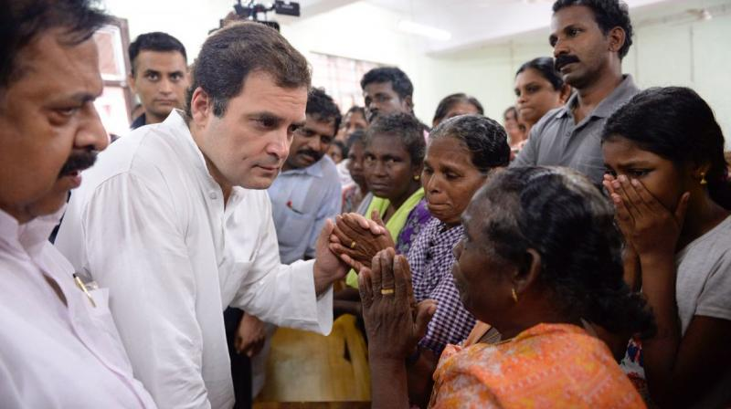 Congress President Rahul Gandhi meets flood affected at the Relief Camp at the Engineering College in Chengannur. (Photo: Twitter | @INCIndia)