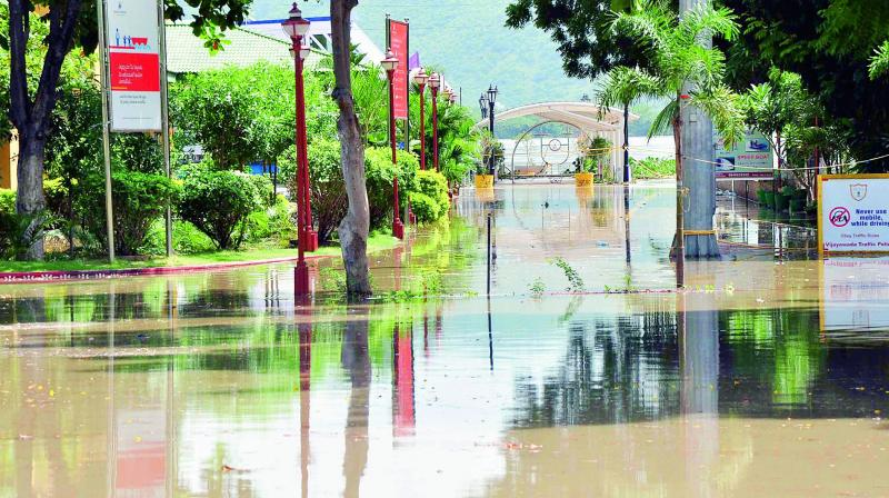 The entrance to the Berm Park in Vijayawada is under a sheet of water following the rising levels of the River Krishna, on Friday. (Photo: DC)