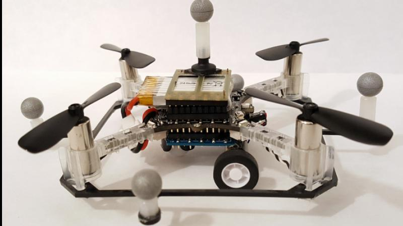 One of the researchers' quadcopter drones with wheels.  Photo: Brandon Araki/MIT CSAIL