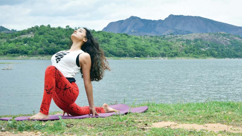 Namita Kulkarni, a yoga practitioner demonstrates an asana