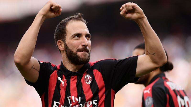 Milan paid 18 million euros ($20.75 million) to sign Higuain on loan, with a clause to make the deal permanent for a further 36 million euros. (Photo AFP)