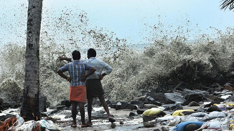 The sea breaches the sea wall as a result of cyclone Ockhi at Chellanam near Kochi on Friday. (Photo: SUNOJ NINAN MATHEW.)