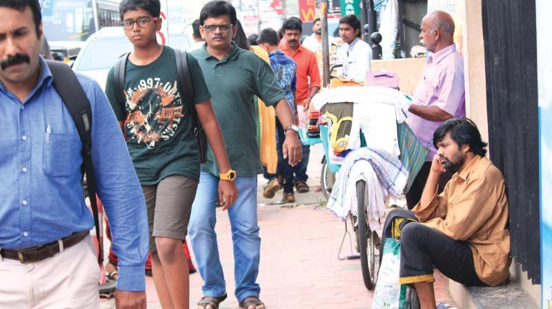 Anumuthu Chinnaraj (far right) on a street in Thiruvananthapuram.