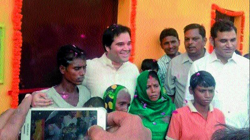 Varun Gandhi with the marginalised farmers at their new pucca houses (Photo: DC)