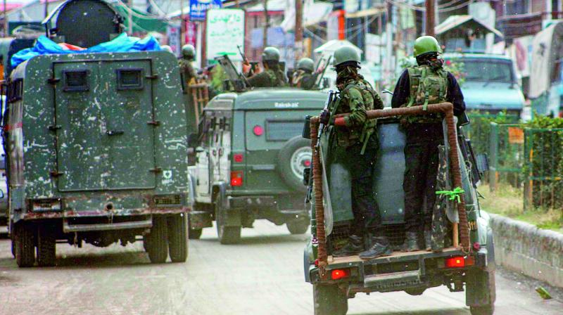 Security personnel near the site of fidayeen attack in Anantnag on Wednesday. 	 (PTI)