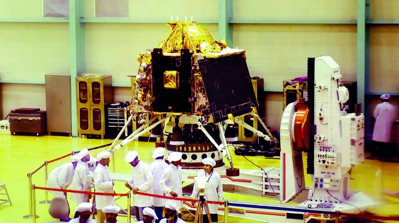 Isro personnel work on the orbiter vehicle of Chandrayaan-2 in Bengaluru on Wednesday. (PTI)