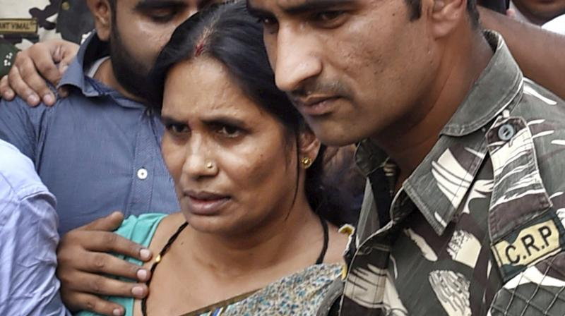 Nirbhaya's mother Asha Devi leaves after the Supreme Court confirmed death sentence for the four convicts in her daughter's gang rape case in New Delhi on Friday. 23-year old Nirbhaya was gangraped and tortured on a moving bus on Dec 16, 2012. (Photo: PTI)