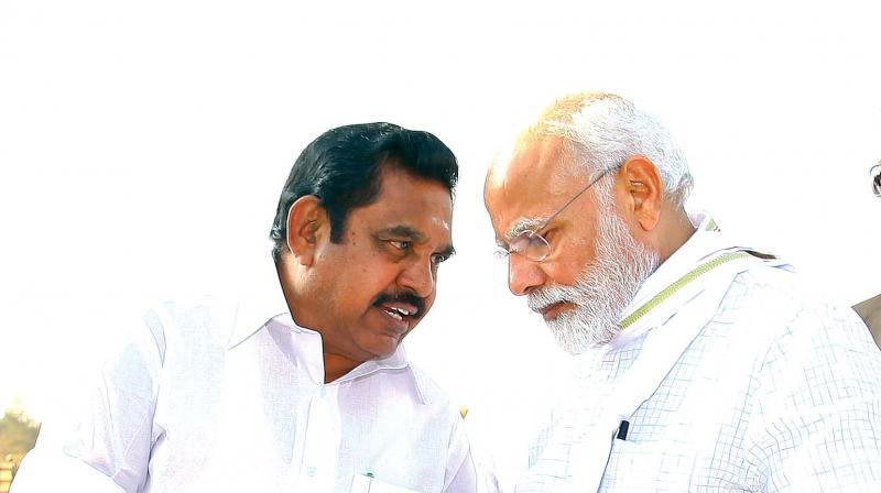 CM Edappadi K. Palaniswami has a word with Prime Minister Narendra Modi as he hands over a memorandum at Tirupur on Sunday.  —DC