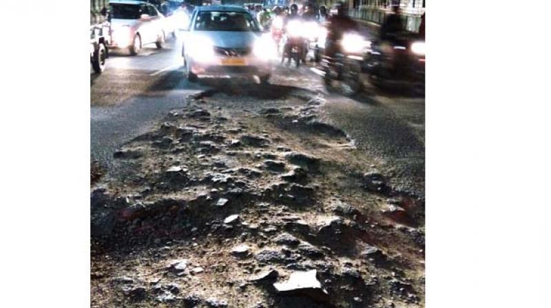 File photo of a huge pothole on Old Madras road near Swami Vivekananda Road Metro station (Image DC)
