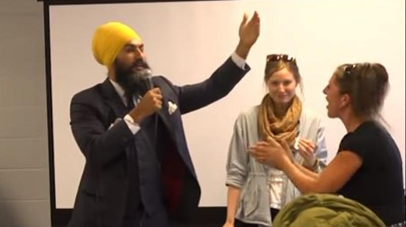 After four full minutes of her rant, the woman left the camping event after Singh attempted to postpone his address and was about to leave the dais. (Photo: Videograb)