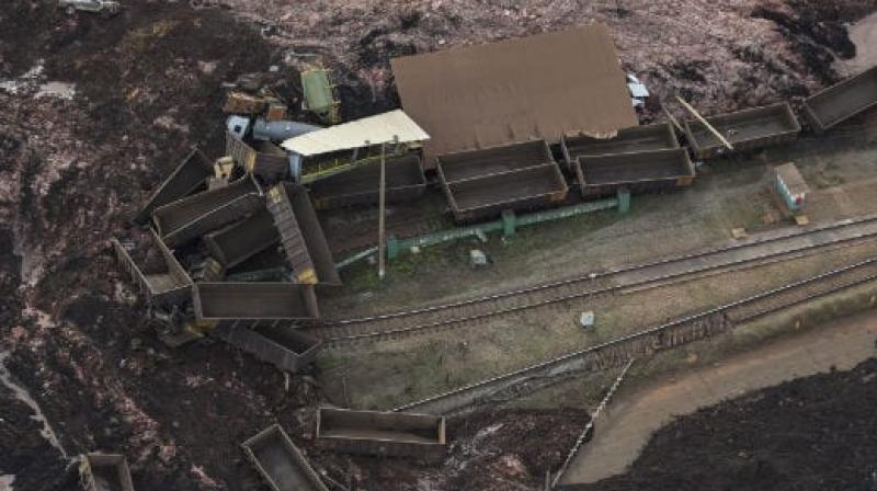 Rescuers worked overnight into Saturday searching for around 300 people missing after a dam collapse. (Photo:Twitter)