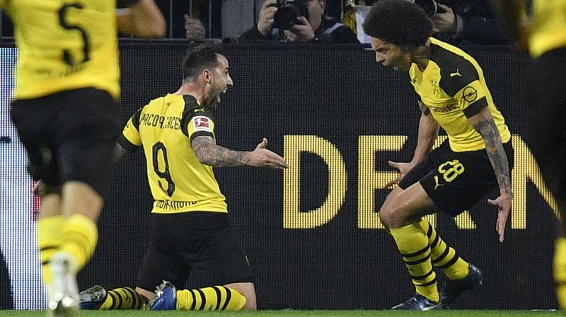 Robert Lewandowski twice put visitors Bayern ahead only for Dortmund captain Marco Reus to equalise each time before Spaniard Alcacer confirmed his 'super-sub' status in the 73rd minute with the decisive goal on the break. (Photo: AFP)