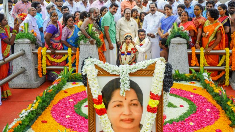 The final resting place of Jayalalithaa was decked up for the occasion with a colourful array of flowers and garlands as S P Sambasivaraman alias Satish, son of city based AIADMK leader S Bhavanishankar, tied the knot with R Deepika in a traditional ceremony. (Photo: PTI)