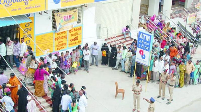 People wait in queue in front of a bank to withdraw cash at Georgepet in Anantapur on Tuesday. (Photo: DC)