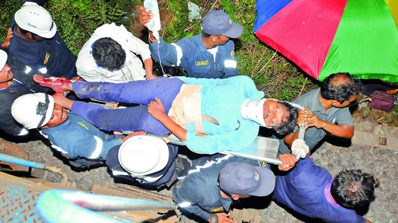 Rescue team carries MMTS driver D. Chandra Shekar to a hospital. (Photo: DC)