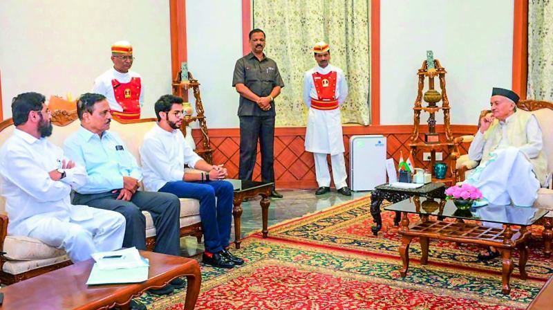 Shiv Sena leaders Aaditya Thackeray and Eknath Shinde meet Maharashtra Governor B.S. Koshyari to stake claim to form government in the state, at Raj Bhavan in Mumbai on Monday evening. (Photo: AP)