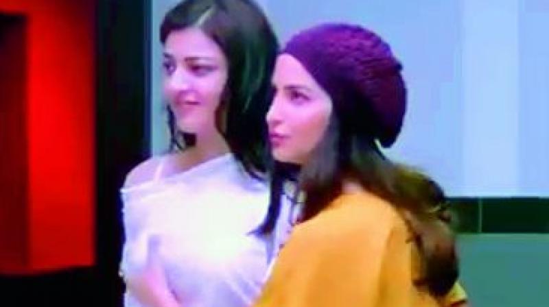 Kajal Aggarwal and Elli Aavram from a scene in Paris Paris.
