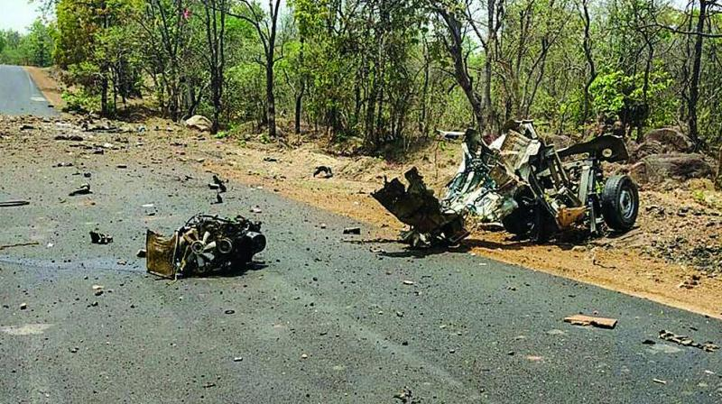 Mangled remains of a police vehicle carrying 16 security personnel that was allegedly bown up by Maoists using IED in Gadchiroli, Maharashtra, on Wednesday. (Photo: PTI)