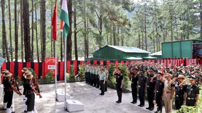 Indian Army and People's Liberation Army (PLA) of China during an event to hand over 5 Indian youths by PLA, at Kibithu in Anjaw district. PTI Photo