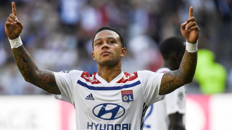 """I want a new transfer to a top level club this summer. Lyon is a big club but it's not one of the five best in Europe,"" the Dutch international told Helden Magazine. (Photo: AFP)"