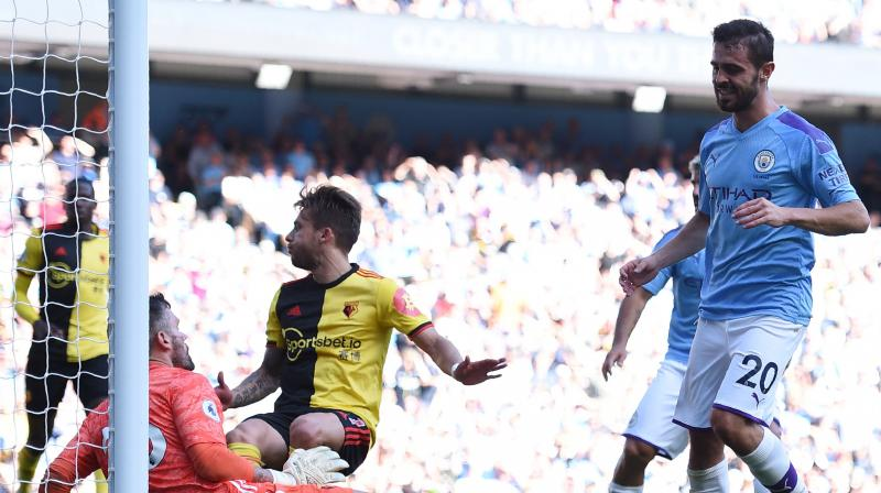 A Bernardo Silva hat-trick helped Manchester City to secure the joint second-biggest Premier League victory in history with an 8-0 thrashing of a bewildered Watford on Saturday. (Photo:AFP)