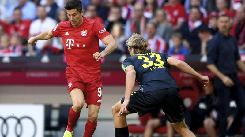 Bundesliga top scorer Robert Lewandowski scored twice to equal a 51-year-old record as champions Bayern Munich demolished Cologne 4-0 on Saturday to climb to the top spot of the standings. (Photo:AFP)