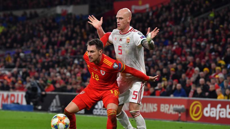 Wales reached their second straight European Championship finals after a goal in each half by midfielder Aaron Ramsey gave them a 2-0 home win over Hungary in their decisive Group E qualifier on Tuesday. (Photo:AFP)