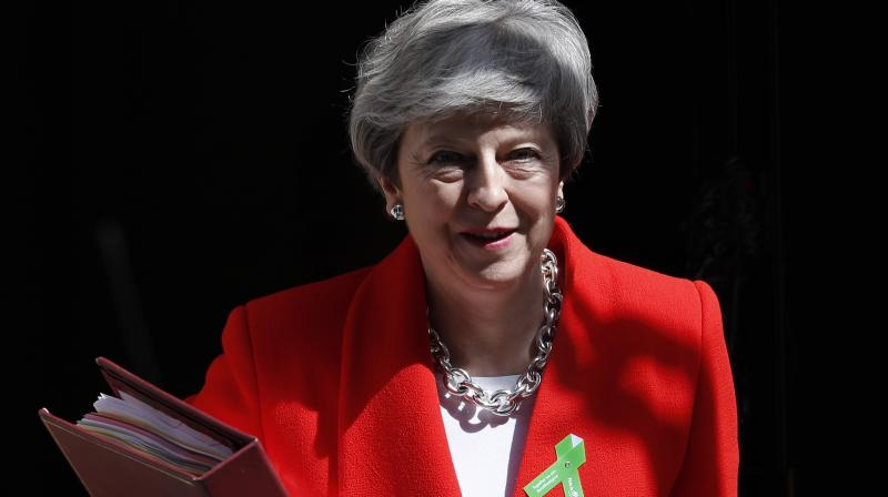 May's Conservatives suffered major losses in local elections this month and are trailing in opinion polls. (Photo:AP)