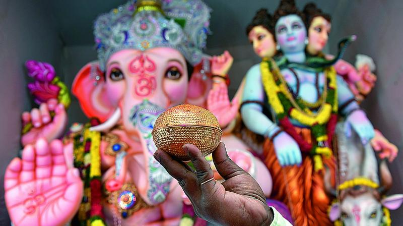A gold laddu that was offered to Lord Ganesha at a pandal in Bholakpur this year.