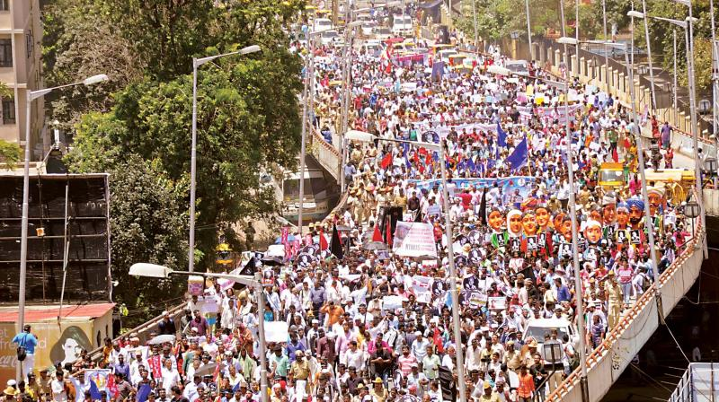"Writers, thinkers, activists and people from all walks of life take part in the ""Rally for Resistance"", condemning the killing of journalist and activist Gauri Lankesh, as they march towards Central College Grounds, in Bengaluru on Tuesday. (Photo: R. Samuel)"