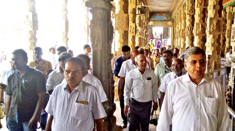 The 12-member expert committee carrying out  inspection at Meenakshi Amman Temple in Madurai  on Thursday. 	— DC