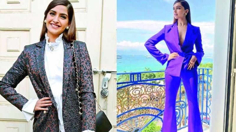 Boss ladies: Actresses Sonam Kapoor and Deepika Padukone nail the pant-suit look.