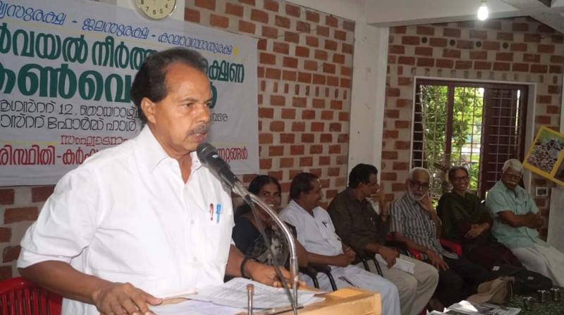 P.T. Thomas, MLA speaks at the convention.