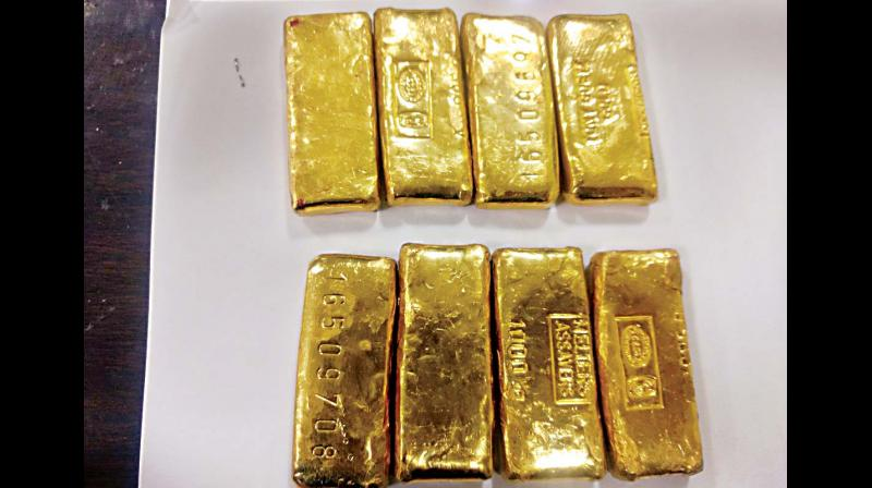 Gold prices fell 0.56 per cent to USD 1,310.70 an ounce in Singapore.