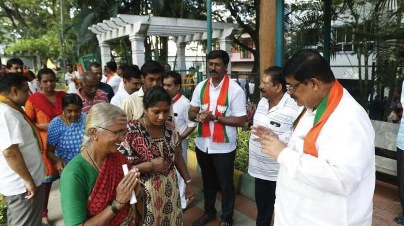 BJP candidate K. Gopalaiah campaigns in Mahalakshmi Layout in Bengaluru on Tuesday. (Photo: DC)