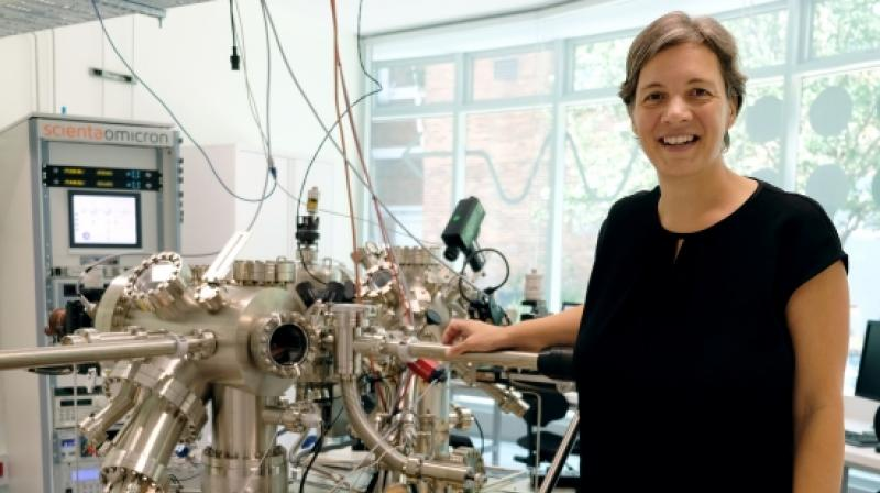 Professor Michelle Simmons with a scanning tunnelling microscope. Photo/UNSW
