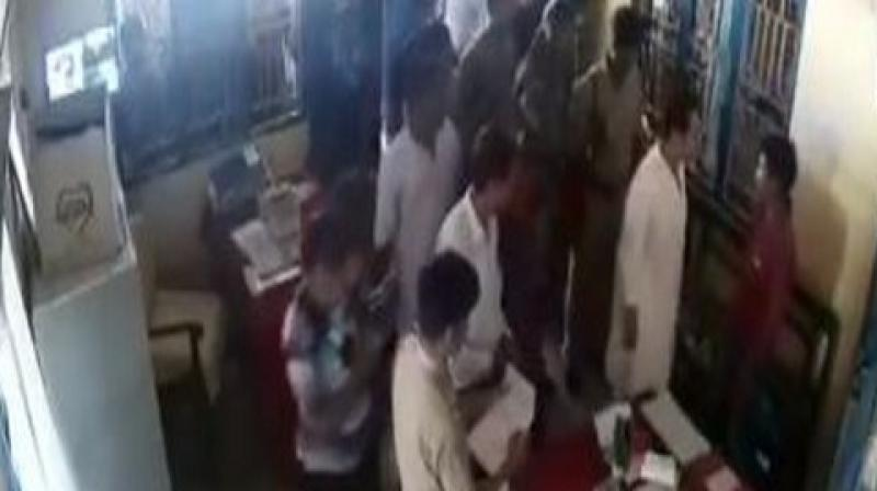 In video footage, Pradyot Burman is seen entering the police station where the accused was seated on a bench. He is seen talking to the accused who greets the leader with folded hands and a few seconds later Burman lands a slap on his cheek. (Photo: ANI)