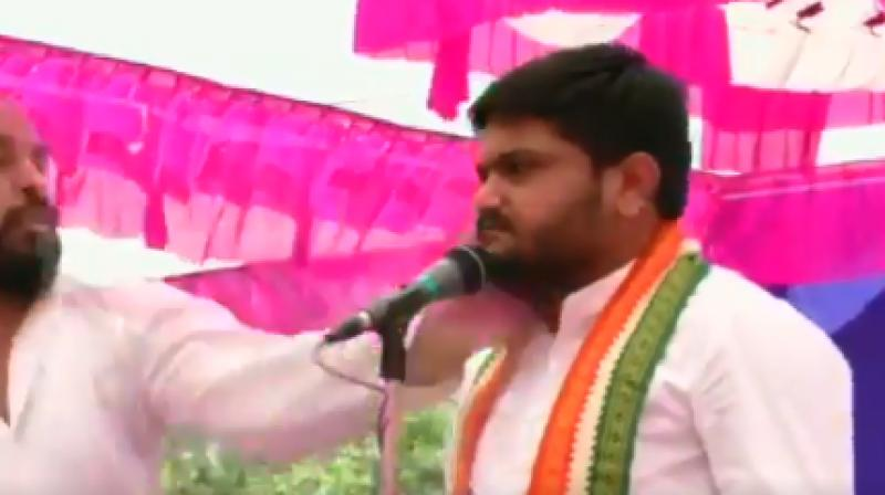 As soon as Hardik Patel started his speech at Baldana village under Wadhwan taluka, a man suddenly came on the stage and slapped him. (Photo: Screengrab)