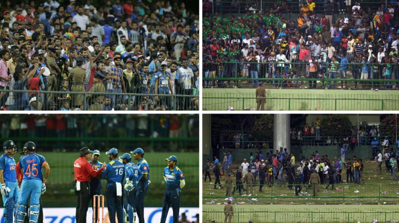 The Indian and Sri Lankan players were sent back into the dressing room, following the rowdy behaviour from Sri Lankan supporters, who resorted to throwing bottles into the field of play. (Photo: AP / PTI)