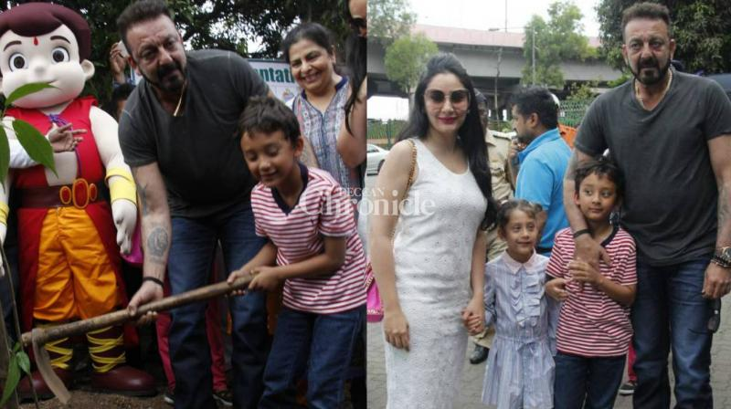 Sanjay Dutt got his kids Iqra and Shahraan involved in a tree-plantation drive conducted by an NGO in Mumbai on Friday. (Photo: Viral Bhayani)