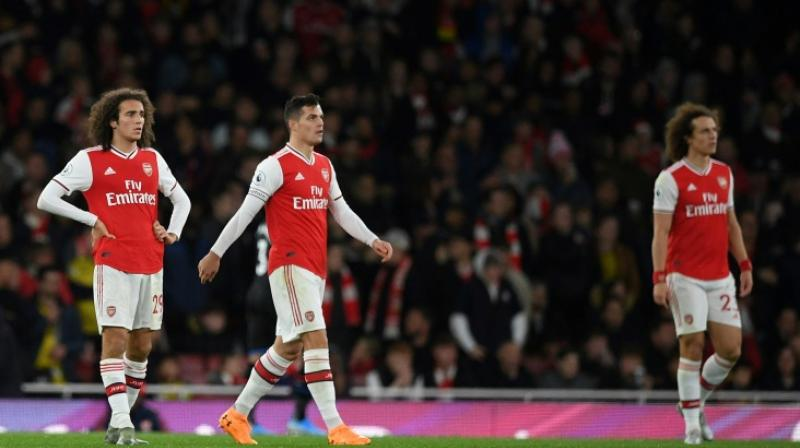 Arsenal manager Unai Emery confirmed on Tuesday that Granit Xhaka has been stripped of the club captaincy after an emotional outburst towards supporters. (Photo:AFP)