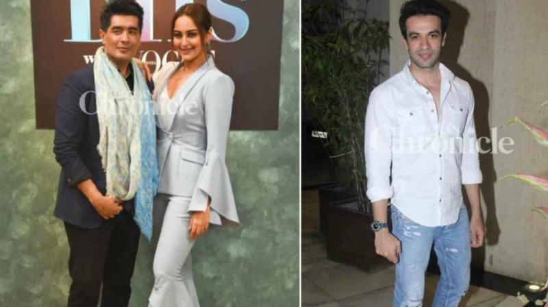 Manish Malhotra poses with Sonakshi Sinha, Punit Malhotra at an event.