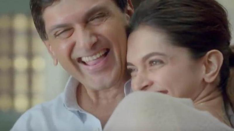 Deepika Padukone with her father in an ad.