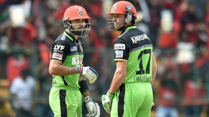 This 'Go Green' initiative takes place every season where Kohli gives a small plant to the opposition captain and the names of the players on the jerseys are replaced by their Twitter handles. (Photo: PTI)