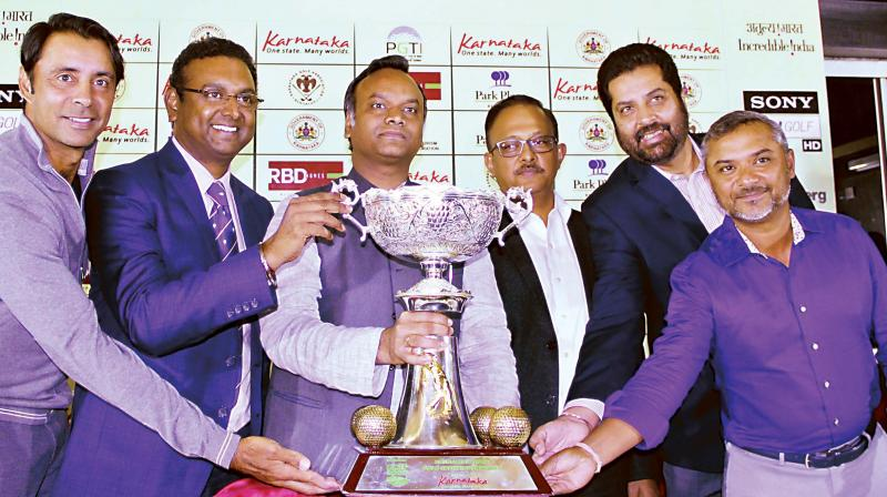 (Left to right) Golfer Jyoti Randhawa, Sandeep Madhavan, President, KGA, Priyank Kharge, Minister for Tourism, Gaurav Gupta, Principal Secretary, Uttam Singh Mundy, CEO, PGTI and golfer Rahil Gangjee unveil the trophy on Tuesday (Photo: R. SAMUEL)
