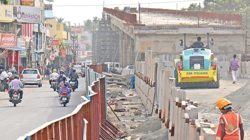 Double-decker bridge work at Velachery-Vijaya Nagar junction is going on at snail's pace. (Photo: DC)